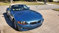 2003 light blue Z4 BMW with beige leather interior and convertible top in excellent condition